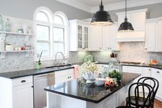 Katie Bower's kitchen is my dream kitchen. I love all the bright white with that marble tile backsplash. The pops of colour are amazing :)