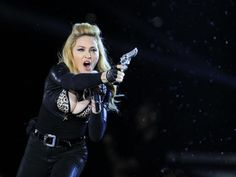 Madonna performs during a concert of her MDNA world tour at King Baudouin Stadium in Brussels, July 12, 2012. REUTERS-Yves Herman