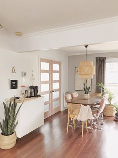 Boho meets Scandinavian inspired dining room. Sektion Ikea hack as a coffee bar.