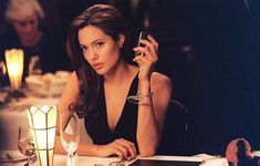 Smith publicity stills and other photos. Featuring Angelina Jolie, Brad Pitt, Adam Brody, Kerry Washington and others. Brad Pitt And Angelina Jolie, Angelina Jolie Photos, Angelina Jolie Tattoos, Mr And Mrs Smith, Ella Enchanted, Celebrity Hairstyles, Girl Crushes, Veronica, Role Models