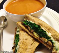 grown up grilled cheese with swiss, steamed spinach, sauteed mushrooms & onions, and tomato soup on the side