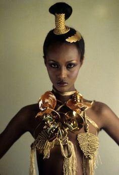 Vogue, December 1977  Photographer: Ishimuro  Model: Iman  Gold & macramé jewelry by Mary McFadden