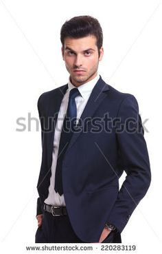 Close up picture of a handsome business man looking at you while holding his hand in pocket