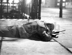 Riots : Belfast. February 1971. The scene in a side street of the Antrim Road, as a soldier lies on the pavement keeping a watch on the area. (01/02/1971) Belfast Telegraph Photosales