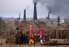 Pakistani girls arrange bricks while working in a brick factory on the outskirts of Islamabad. (Muhammed Muheisen/Associated Press) #
