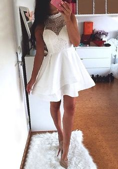Look so sensual in this white lace illusion neck dress. It's a partially lined, stretchable piece that features an A-line skirt, mock neckline and back zipper. Purchase this here.   Lookbook Store