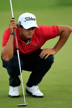 Adam Scott of Australia lines up his putt on the 18th green during the first round of the World Golf Championships-Bridgestone Invitational on the South Course at Firestone Country Club on August 4, 2011 in Akron, Ohio.