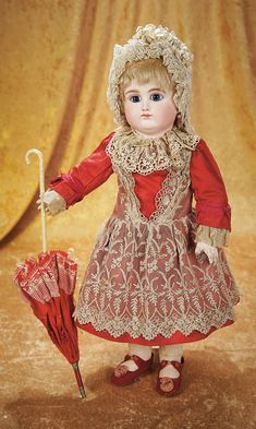 "French Bisque Bebe by Schmitt et Fils in Original Red Silk Dress, 19"" (48 cm.) Theriault's Antique Doll Auctions"