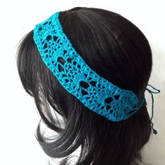 Delicate lace cotton headband crocheted with #10 mercerized cotton thread in a pineapple motif. This 2 inch wide headband measures about 17 inches in length with 10 inch straps for securing behind head. This headband fits all adult size heads.