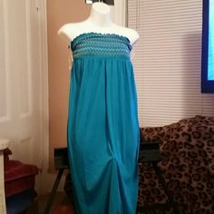 A multi-purpose teal strapless dress This cute strapless dress can be worn as a skirt,  over your bathing suit, with a lightweight blazer for those Sumner cool nights. Why wait until summer? Dots Dresses Strapless