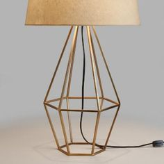 Crafted of cast iron with a warm brass finish and an open, diamond-shaped design, our mid-century-style table lamp adds a unique geometric presence to any room. Top it with any of our table lamp bases to create a personalized look. Table Lamp Shades, Table Lamp Base, Bedside Table Lamps, Bedroom Lamps, Desk Lamp, Retro Lampe, Geometric Lamp, Large Lamps, Brass Lamp