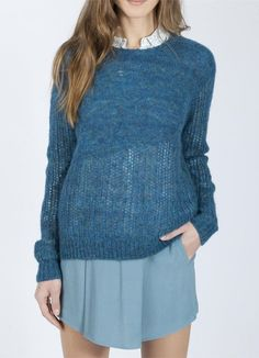 A pullover sweater from Yerse in vibrant peacock blues with subtle shimmering gold threads.