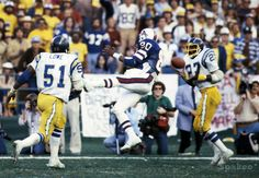 San Diego Chargers defensive back Glen Edwards (27) intercepts a pass for Buffalo Bills receiver Jerry Butler (80) during the 1980 AFC Divisional Playoff Game at Jack Murphy Stadium. The Chargers defeated the Bills 20-14