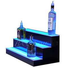 #amazing These 3 #Step Illuminating Shelves provide drama and beauty for bottles and glassware. This shelf features a thin first level shelf, with two taller she...