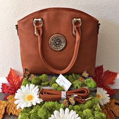 Pumpkin Fritter Handbag Brand New With Tags! Never Used! Has a 'spot free' exterior so if something gets on it, you just wipe and it comes off!:) Has a spacious interior to hold all of your must have essentials!:) Description: Exterior Beauty, Exterior Backside Zippered Pouch, Two Interior Pockets, Center Divider, Two Interior Zippered Pouches, Adjustable & Detachable Shoulder/Crossbody Strap.❗️Depending on lighting the color can look lighter or darker:)❗️ Boutique Bags Crossbody Bags