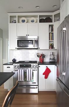 Kitchen cabinets extended with open shelving to the ceiling - love this look, and I think it would be pretty simple to do, and would give our tiny kitchen so much more personality!
