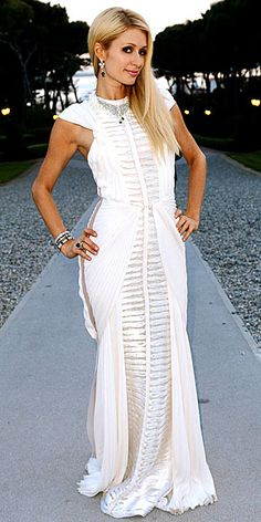 PARIS HILTON  The socialite makes her requisite appearance in a trendy sheer-paneled white gown and her signature blonde locks.