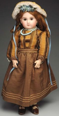 """At Auction: April 27th. Delightful French Incised Jumeau Bébé Doll. Nicely redressed, antique undies, antique shoes marked """"C.C. 12."""" Just a beautiful face, seldom see this model in this large size! #Jumeau #Bebe #Dolls #MorphyAuctions"""