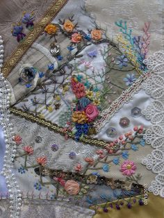 Crazy quilted block in pastel colours.  Features my hand dyed threads and silk ribbon.  Will be made up into a purse