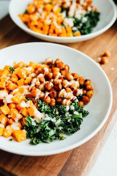 This vegan power bowl is loaded with roasted sweet potatoes and kale, spicy chickpeas and a creamy white bean dressing. Recipe from Terra's Kitchen.