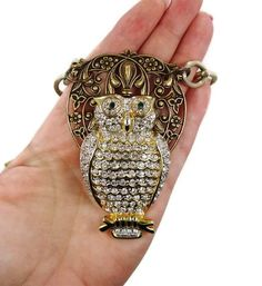the rest of the necklace is ugly, but the pendant is very nice. Would look great on a topaz colored velvet ribbon.  HUGE Owl Necklace - Vintage Chunky Assemblage - Multi Strand - One of a Kind - InVintageHeaven