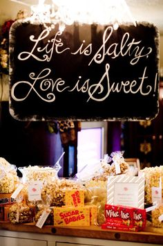 Salty & Sweet candy and popcorn bar signage.  Photo by Traina Photography. #wedding #sign #candybar