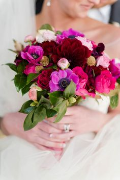 Bridal Bouquet in Red Hearts Roses, Fuchsia Anemones, Burgundy Dahlias, Fuchsia Cabbage Roses, Gold Pods, Blush Ranunculus,  Flowers by www.KarrieHlistaDesigns.Com Photo by: www.leeannmariephotography.com