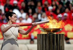 Symbolic moment: Greek actress Maria Nafpliotou with the Olympic flame in Athens {in 2008 for the Bejing Olympics...but I still thought it was cool! ;)}