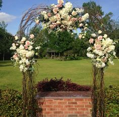 Floral & curly willow ceremony arch by La Belle Fleur www.significanteventsoftexas.com #significanteventsoftexas