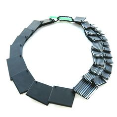 Beautiful cut and polished glass necklace by Erica Rosenfeld. Gallery Lulo.