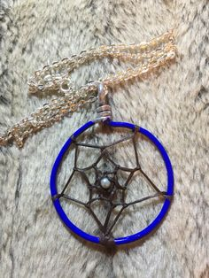 Hand wrapped, woven and painted blue dreamcatcher necklace woth light mint blue glass pearl and 18' nickel free chain by EarthDiverCreations on Etsy https://www.etsy.com/ca/listing/483309652/hand-wrapped-woven-and-painted-blue