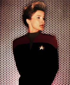 Captain Janeway. I don't know how girls can worship bimbos when a character like her exists.