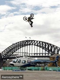 Travis Pastrana jumps his bike over a hovering Jetranger. That's just epic