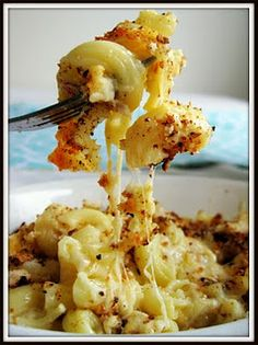 Slow- Baked Mac and Cheese - I put 4 cups of cheese instead of 3 because, well, you can never use too much cheese. Def use the low fat evaporated milk...it keeps it from curdling. Also, the two hours of low cook time was unnecessary. Keep an eye on it.