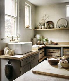 Modern rustic kitchen with huge belfast sink and brass taps, grey kitchen cabinets and earthy ceramics on open shelves Country Kitchen, New Kitchen, Kitchen Dining, Kitchen Decor, Kitchen Rustic, Kitchen Ideas, Modern Rustic Kitchens, Kitchen Vignettes, Natural Kitchen