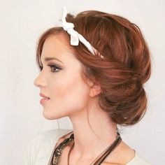 Wanting a ton of volume without having to tease your hair or use bobby pins? This updo hairstyle is perfect for you. Emily from The Freckled Fox walks you through this textured, messy look in a few detailed steps.