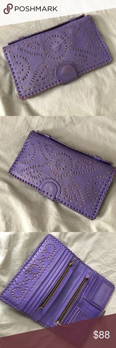Cleobella Mexicana purple large wallet/clutch. So many zippers and compartments.The best wallet you'll ever own- the Mexicana is a fan favorite for its interior organization and tooled leather pattern. Slightly oversized to ensure you have room for all your treasures, this wallet is created by hand, making each one a unique work of art. Leather feels luxurious to the touch and will only get better with age.  Wear shows on the paint of the purple part of button snap and edges. Cleobella Bags…