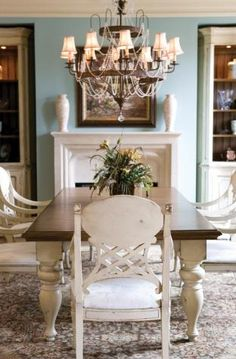 country dining room meets victorian chandelier