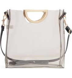 "11""W x 11""H x 3 1/2 ""D. (Interior capacity: medium.) 15"" – 26"" convertible strap drop. .70lbs. Details & Care Gleaming goldtone handles put the polish on a mod transparent handbag fitted with a slim shoulder strap. Cutout carry handles Shoulder strap Synthetic #womensfashion #bags"