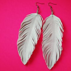 Gorgeous statement earrings, the Feathers hand cut from faux leather material in white. I have created these with intricate hand cuts to move and feel