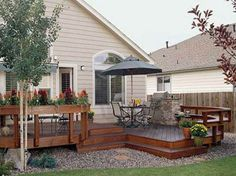 Railing...maybe lower for plants - Find the Right House Deck Plans  with the umbrella