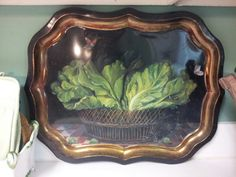 """I like to use old trays as my kitchen """"back splash"""". It keeps them handy for use also."""