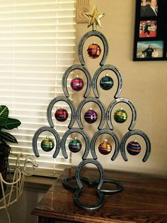 40 Unique Christmas Tree Decor Ideas 13 – Home Design Horseshoe Christmas Tree, Unique Christmas Trees, Cowboy Christmas, Christmas Table Decorations, Decoration Table, Xmas Tree, Country Christmas, Horse Decorations, Holiday Tree