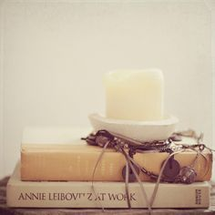 book stack with candle top