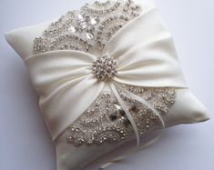 Items similar to Wedding Ring Pillow, Wedding Cushion with Rhinestone Detail, Ring Bearer Pillow, Ivory Satin Sash Cinched by Crystals - The ROSALINA Pillow on Etsy Wedding Ring Cushion, Cushion Ring, Wedding Pillows, Satin Bows, Ring Bearer Pillows, Ring Pillows, Rhinestone Appliques, Flower Girl Basket, Wedding Bands