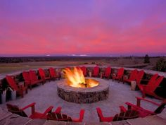 With a backdrop of snowcapped mountains, guests of Brasada Ranch enjoy watching the sunrise around the resort's large fire pit. It is also the centerpiece for many rustic, romantic wedding receptions.