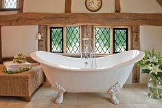 Looking for an English country house feel for your wedding? Relax in this stunning roll top bath at Cain Manor in Surrey