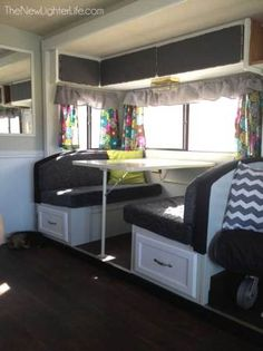 RV Remodel Archives. Great cabinetry re-model, works especially well with the dark gray cushions but those curtains...damn, that is a terrible print.