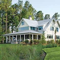 Exterior: The Sides & Back | The Palmetto Bluff Idea House proves that a modest house can still be dramatic. The cheerful colors, familiar barn forms, and classic materials balance the home's impressive back side.