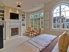 Plenty of natural light and this master bedroom ... like the sitting area as well | http://homechanneltv.com/ #masterbedrooms #mastersuites